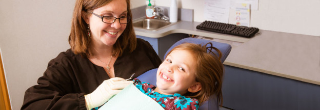 Young girl with dental hygienist at Smiles 4 Keeps